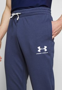 Under Armour - SPORTSTYLE - Tracksuit bottoms - blue ink/onyx white - 4