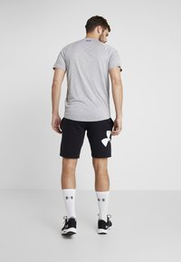 Under Armour - RIVAL LOGO SHORT - Träningsshorts - black/white - 2