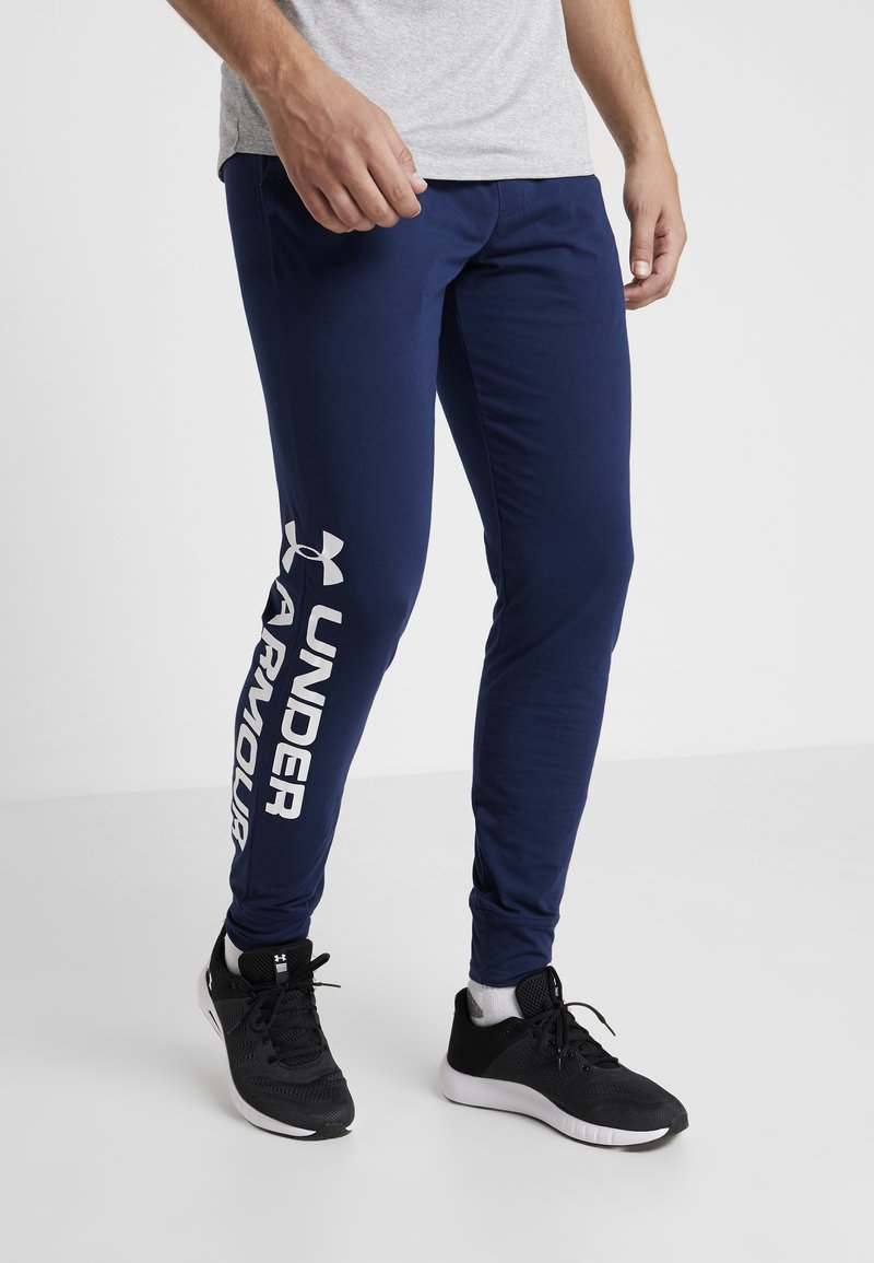 Under Armour - SPORTSTYLE GRAPHIC  - Tracksuit bottoms - academy/white