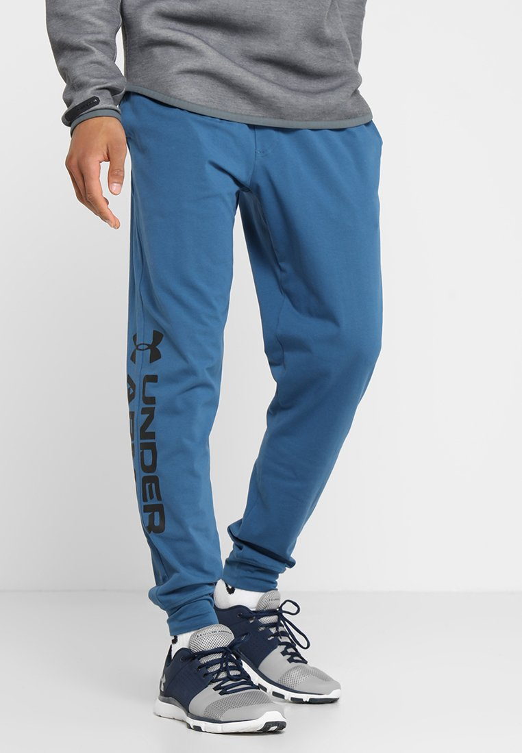 Under Armour - SPORTSTYLE GRAPHIC  - Jogginghose - petrol blue/black