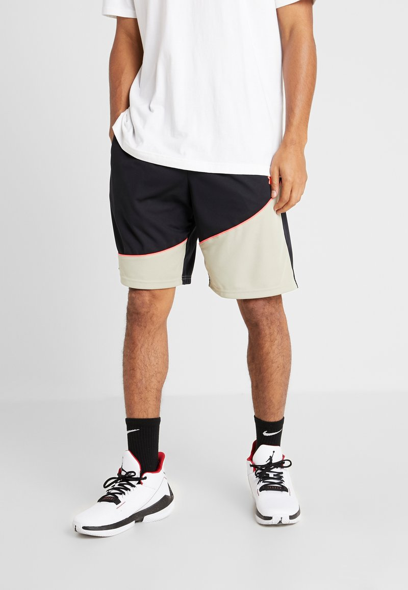 Under Armour - BASELINE SHORT - Sports shorts - black/range khaki/beta red
