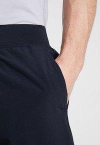 Under Armour - SPEEDPOCKET LINERLESS SHORT - Pantaloncini sportivi - black/reflective - 3