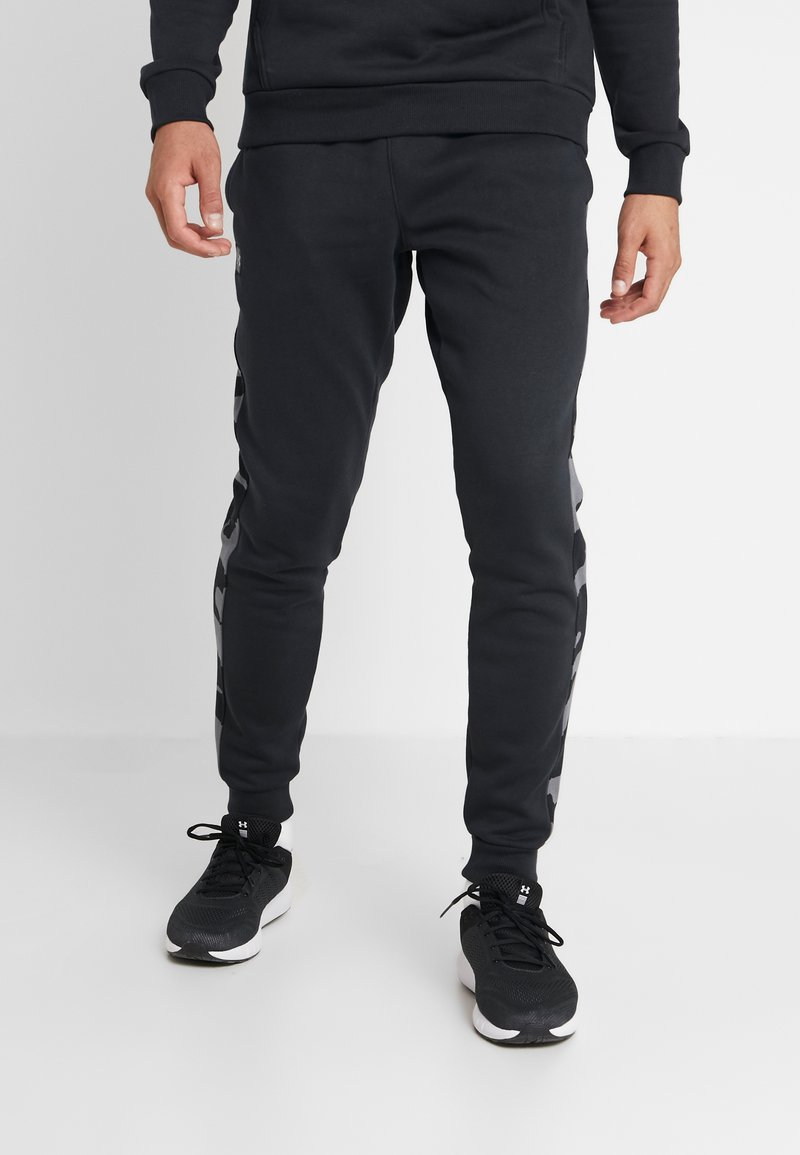 Under Armour - RIVAL PRINTED - Tracksuit bottoms - black