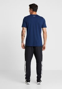 Under Armour - UNSTOPPABLE TEARAWAY PANT - Träningsbyxor - black/white - 2