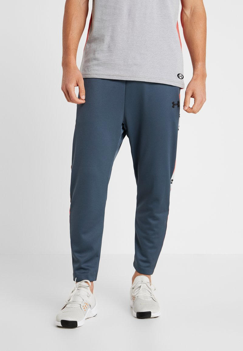 Under Armour - UNSTOPPABLE TRACK PANT - Tracksuit bottoms - wire/black