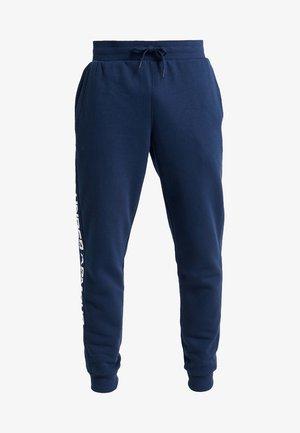 RIVAL WORDMARK LOGO - Pantalones deportivos - academy/white