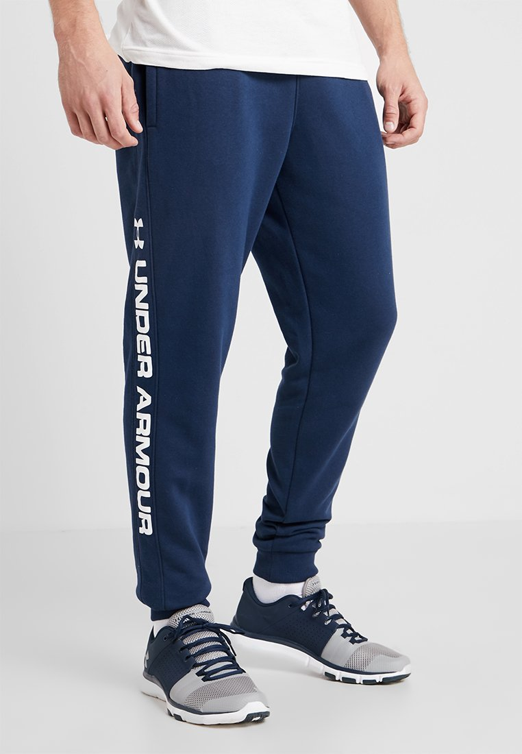 Under Armour - RIVAL WORDMARK LOGO - Tracksuit bottoms - academy/white