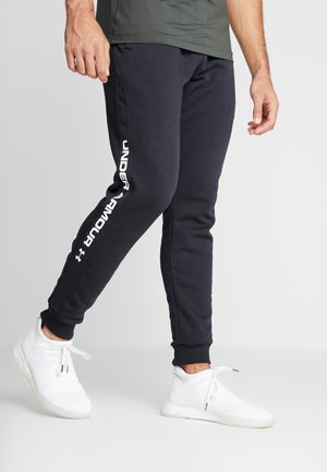 RIVAL WORDMARK LOGO - Tracksuit bottoms - black