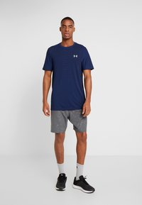 Under Armour - GRAPHIC EMBOSS SHORTS - Sports shorts - pitch gray/vapor green