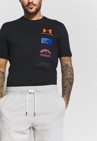 Under Armour - SPECKLED SHORT - Krótkie spodenki sportowe - onyx white/black