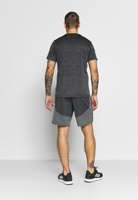 Under Armour - KNIT TRAINING SHORTS - Sports shorts - black/mod gray - 2