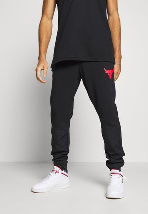 PROJECT ROCK - Pantalones deportivos - black full heather/versa red