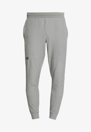 UA FLEX WOVEN JOGGERS - Pantalones deportivos - gravity green/black