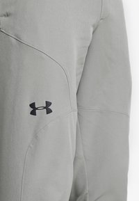 Under Armour - FLEX WOVEN JOGGERS - Tracksuit bottoms - gravity green/black - 6
