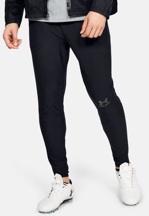 ACCELERATE - Tracksuit bottoms - black
