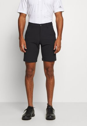 TECH  - Sports shorts - black