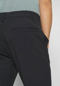 Under Armour - TECH PANT - Spodnie materiałowe - black - 5