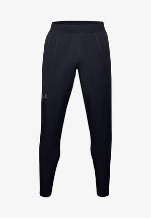 UA FLEX WOVEN TAPERED PANTS - Tracksuit bottoms - black