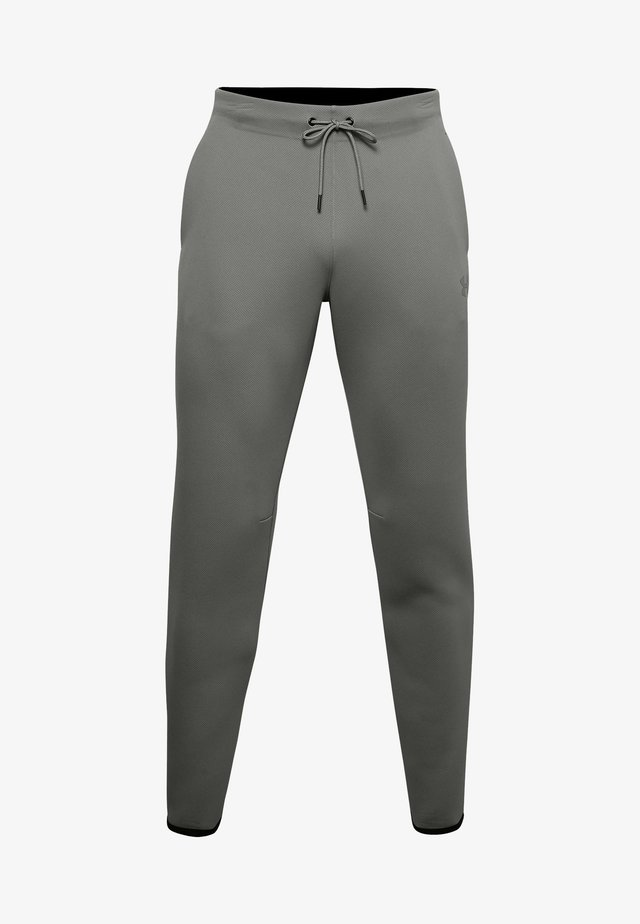 MOVE PANTS - Tracksuit bottoms - gravity green