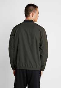 Under Armour - UNSTOPPABLE ESSENTIAL BOMBER - Giacca sportiva - baroque green/baroque green - 2