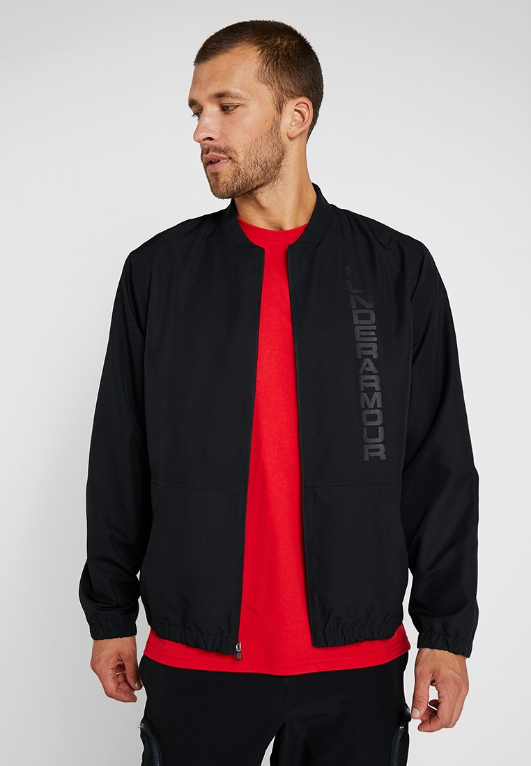 Under Armour - UNSTOPPABLE ESSENTIAL BOMBER - Träningsjacka - black