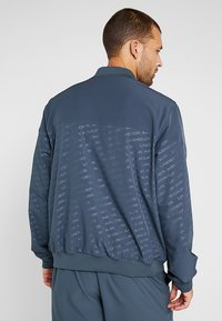 Under Armour - UNSTOPPABLE EMBOSS BOMBER - Training jacket - wire/black - 2