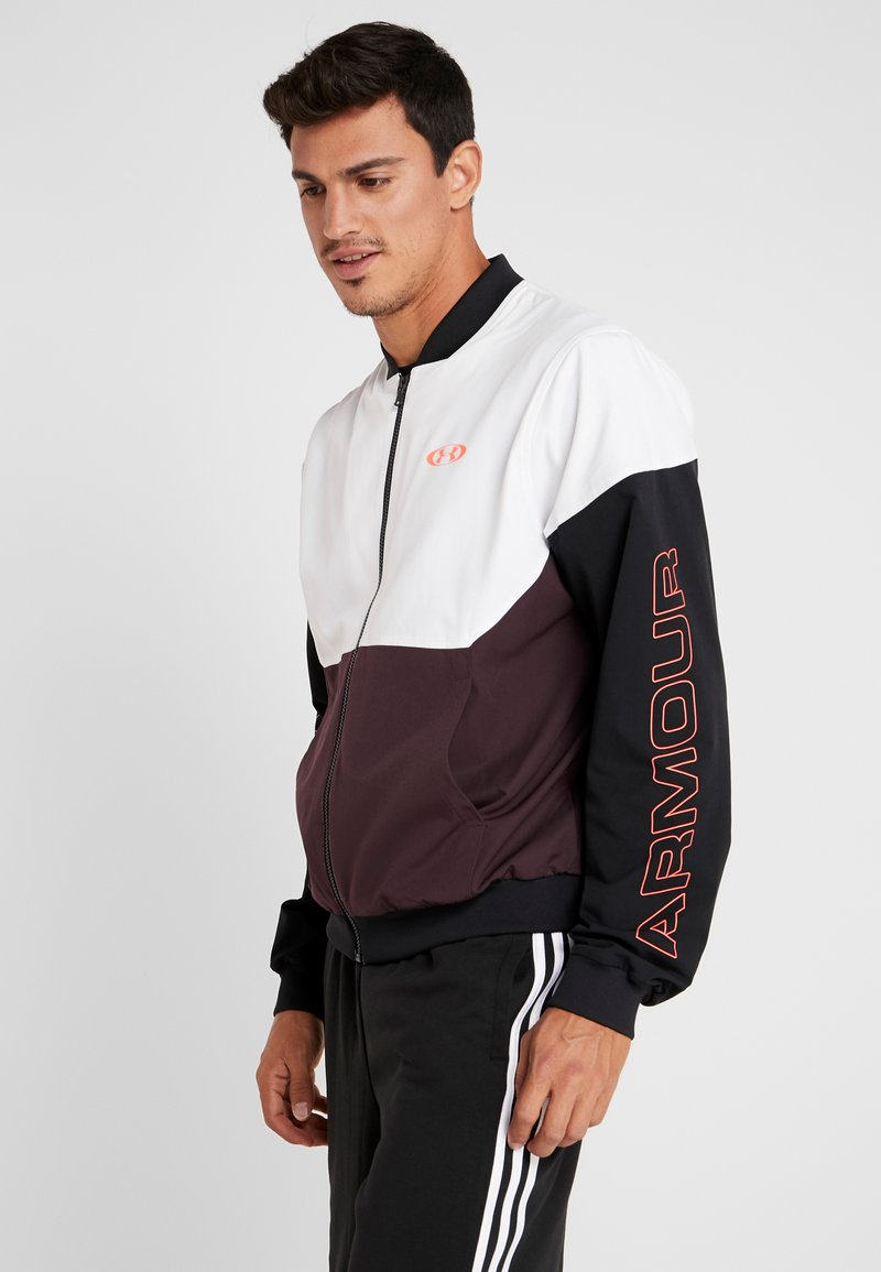 Under Armour - UNSTOPPABLE BOMBER - Träningsjacka - white/kinetic purple/beta red