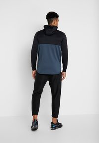 Under Armour - UNSTOPPABLE TRACK JACKET - Treningsjakke - black/wire - 2