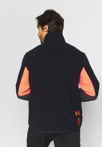 Under Armour - REVERSIBLE SNAP JACKET - Fleece jacket - jet grey/black - 2