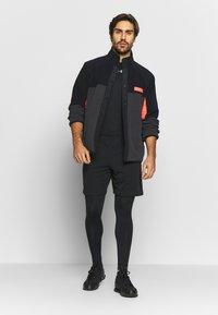 Under Armour - REVERSIBLE SNAP JACKET - Fleece jacket - jet grey/black - 1