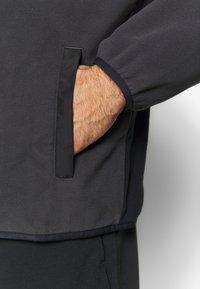 Under Armour - REVERSIBLE SNAP JACKET - Fleece jacket - jet grey/black - 6