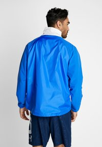 Under Armour - ZIP JACKET - Training jacket - versa blue/ultra orange/onyx white - 2