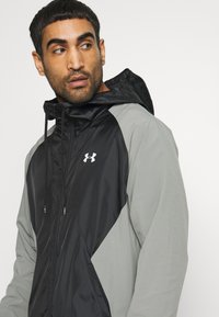 Under Armour - HOODED JACKET - Trainingsjacke - gravity green / black / onyx white