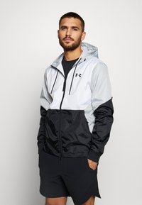 Under Armour - FIELD HOUSE JACKET - Waterproof jacket - white/black - 0