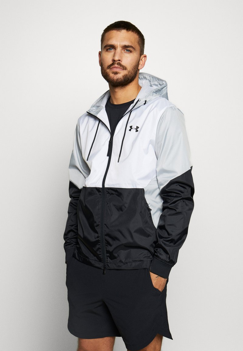 Under Armour - FIELD HOUSE JACKET - Waterproof jacket - white/black