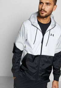 Under Armour - FIELD HOUSE JACKET - Waterproof jacket - white/black - 3