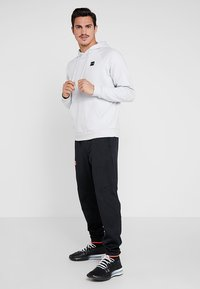 Under Armour - RIVAL HOODY - Hoodie - halo gray/black - 1