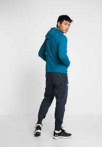 Under Armour - RIVAL HOODY - Mikina s kapucí - teal vibe/black - 2