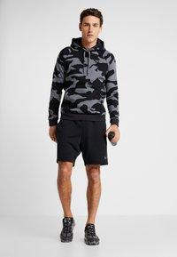 Under Armour - RIVAL CAMO HOODY - Hoodie - pitch gray/black - 1