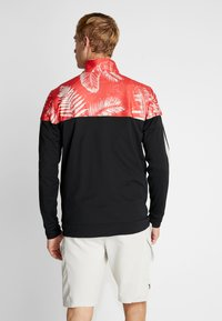 Under Armour - PROJECT ROCK TRACK JACKET - Veste de survêtement - black/versa red