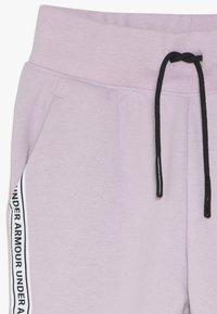 Under Armour - SPORTSTYLE PANT - Teplákové kalhoty - pink fog/black - 4