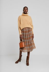 UNIQUE 21 - PLEATED SKIRT IN CHECK PRINT - Jupe trapèze - mustard - 1