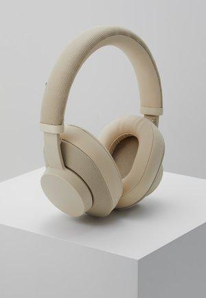 PAMPAS - Høretelefoner - almond beige