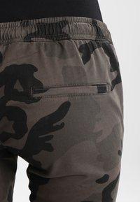 Urban Classics - LADIES CAMO PANTS - Trousers - grey - 4