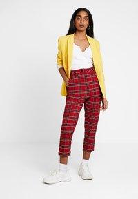 Urban Classics - LADIES HIGHWAIST CHECKER CROPPED PANTS - Kalhoty - red/black - 1