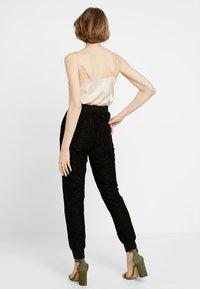 Urban Classics - LADIES PANTS - Trousers - black - 2