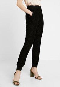 Urban Classics - LADIES PANTS - Trousers - black - 0