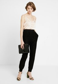 Urban Classics - LADIES PANTS - Trousers - black - 1