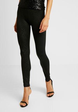 LADIES PATTERN - Leggings - Trousers - black