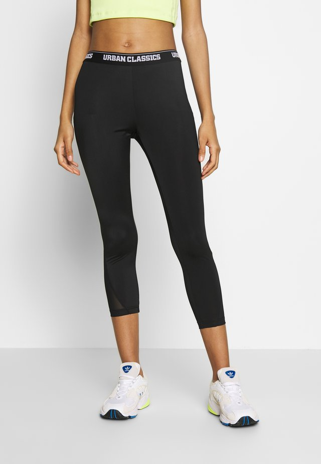 LADIES TECH PEDAL PUSHER - Leggings - Trousers - black